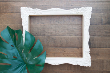 Vintage style picture flame and plant leaf on wooden wall, Creative space