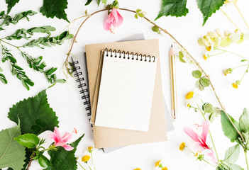 Top view flat lay empty note book with summer leaves and daisy flowers mockup. Text space