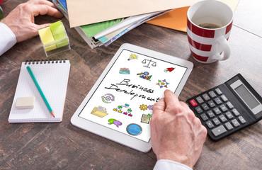 Business development concept on a tablet