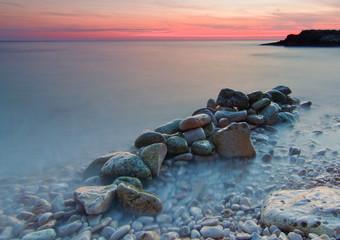 A rocky beach in Croatia. Long exposure of the photo.