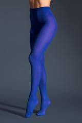 Slim woman in blue pantyhose on dark background