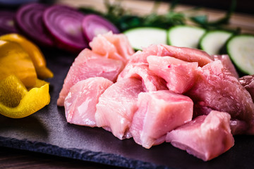 Raw chicken strips with vegetables