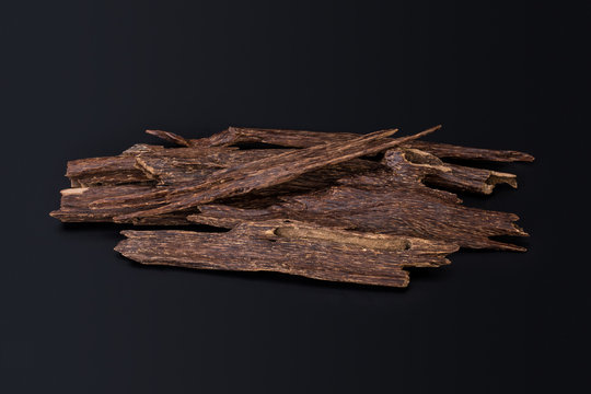 Close Up Macro Shot Of Sticks Of Agar Wood Or Agarwood Isolated On Black Background The Incense Chips Used By Burning It Or For Arabian Oud Oils Or Bakhoor