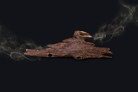 Close Up Macro Shot Of Sticks Of Agar Wood Or Agarwood Isolated On Black Background  With the smoke The Incense Chips Used For Arabic Oud Oils Or Bakhoor