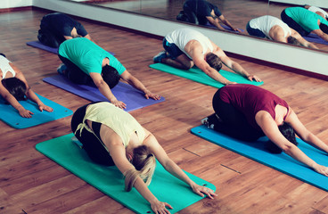 men and ladies learning yoga