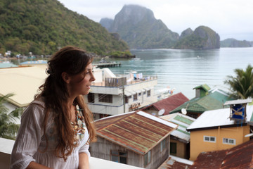 Attractive woman enjoys a view of El Nido, Palawan Island, Philippines