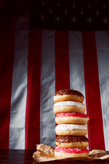 Set of different donuts against the background of the American flag