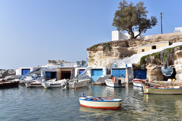 View over fishing harbour with boats and colourful boat houses, Mandrakia, Milos, Cyclades, Greece