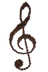 Treble clef symbol made of coffee beans on isolated white background.