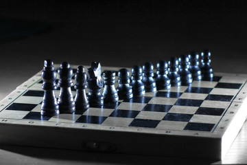 black pieces on a chess Board . photo with copy space