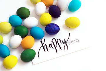 Easter festive colorful eggs on a white background. eggs yellow, blue, green and blue, orange and violet