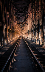 Old metal train bridge with dramatic colors