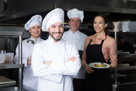 Chef in kitchen with staff