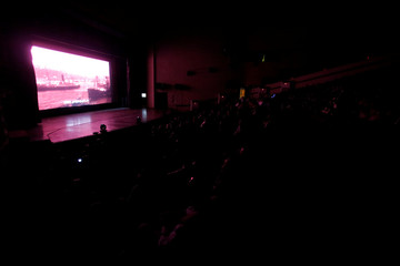 People watch ''Letters from Baghdad,'' a documentary about Gertrude Bell, for the first time in Iraq at the National Theater of Baghdad