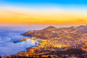 Night scene with cityscape of Funchal capital, Madeira island, Portugal