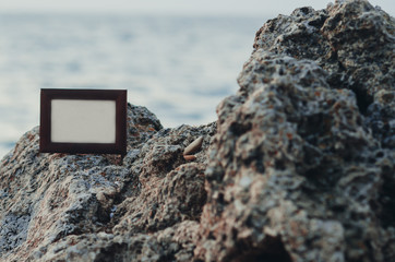 Photo frame stone, sea at sunset place for lettering, copyspace
