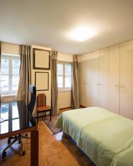 Interiors of modern apartment, bedroom
