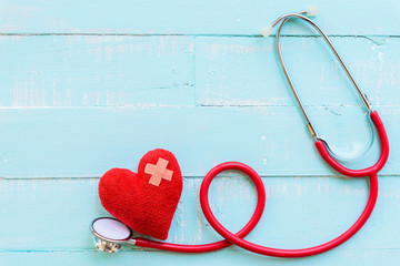 World health day, Healthcare and medical concept. Stethoscope and red heart on Pastel white and blue wooden table background texture.