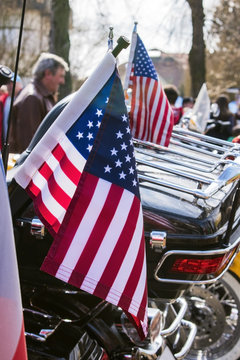 USA Flags are displayed at the back of motorbike on Czech Motor season opening. Close up view