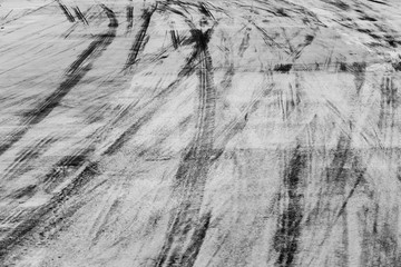 Abstract background black tire tracks on cement road, Tire trace on the ground, tire marks on cement road.