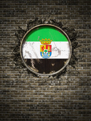 Old Extremadura flag in brick wall