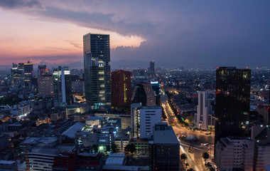 Wall Mural - Aerial view of mexico city downtown skyscrappers at sunset time before night.