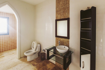 Bathroom with Shower, toilet, banana tree design on white wall and brown Tile. Open window, casual interior