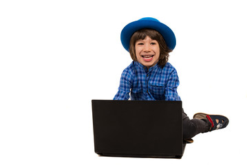 Laughing boy with laptop