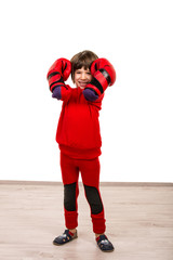 Smiling boy with red boxing gloves