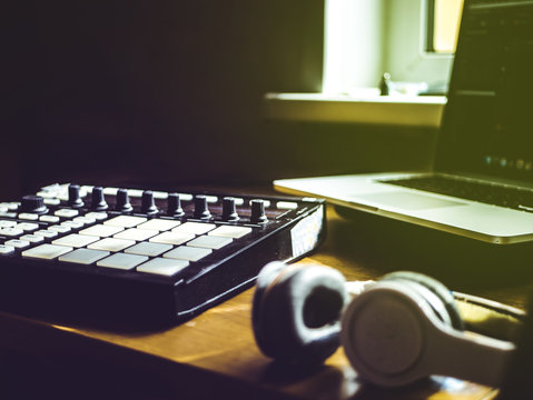 making hip hop beats on the drum machine controller at the home studio