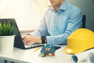 architect construction engineer working with laptop in office