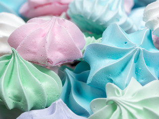 Close-up view of colorful mini meringue cookies
