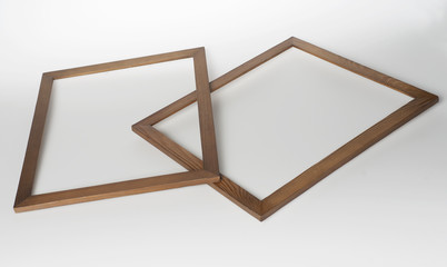 two wooden photo frames on a white background