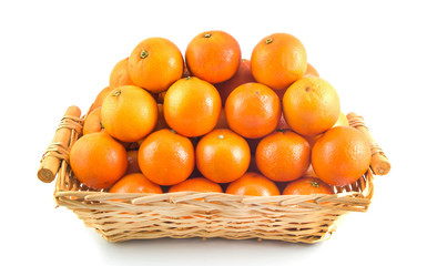 Fresh orange, organic ripe mandarins, pile of orange in wood basket on white background with clipping path.