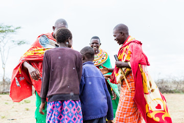 Massai tribe family celebrating and dancing