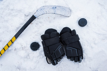 hockey player lying on the snow at the stadium