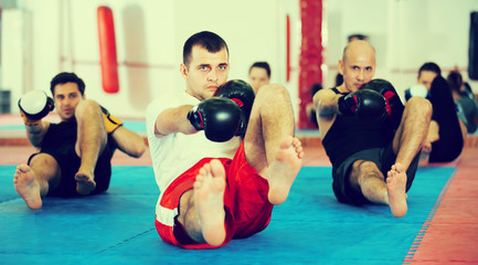 Group of people training in the boxing hall