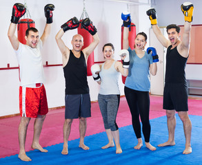 Portrait of  females and  males training in boxing gloves