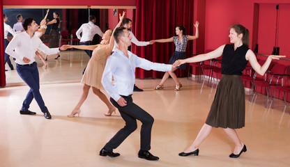 People practicing vigorous lindy hop movements