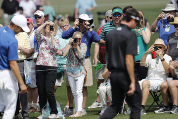 Patrons use cameras to take pictures during practice for the 2018 Masters golf tournament in Augusta