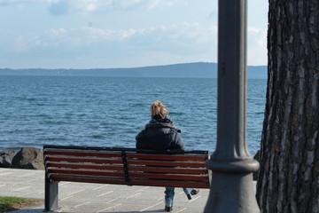 woman sitting at the lake