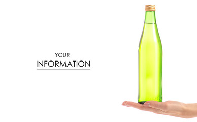 Glass bottle of soda carbonated lemonade water in hand pattern
