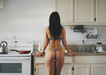 sexy women in bra and panties cooking in kitchen