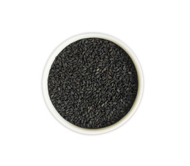 Black sesame on white background. Top view. Black sesame in a bowl isolated on white background. Sesame with copy space for text.