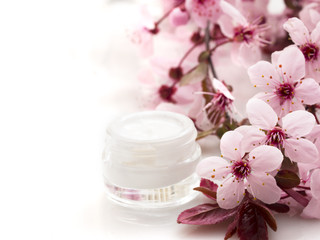 cosmetic product with spring flowers, fresh as spring concept