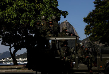 Brazilian Marines patrol the streets of Botafogo neighbourhood with Sugarloaf Mountain in the background in Rio de Janeiro