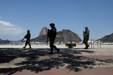 Brazilian Marines patrol the Botafogo neighbourhood with Sugarloaf Mountain in the background in Rio de Janeiro