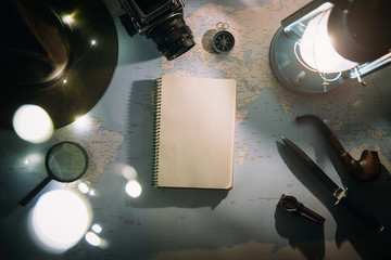 Adventure planning near gas lamp flat lay. Atmospheric old gear on map. Empty notepad copyspace. Wanderlust, hiking empty space poster, postcard, template.