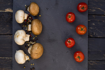 White and brown mushrooms. Cherry tomatoes. Top.
