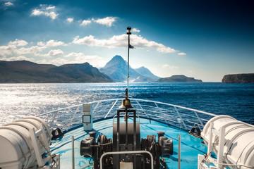 Scenic view of boat, sea and mountain, Crete, Greece